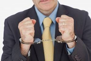 Image credit: <a href='http://www.123rf.com/photo_18126426_close-up-of-businessman-with-handcuffed-hands-over-white-background.html'>wavebreakmediamicro / 123RF Stock Photo</a>