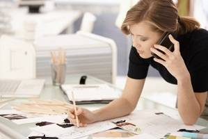 Image credit: <a href='http://www.123rf.com/photo_8784138_young-attractive-female-fashion-designer-working-at-office-desk-drawing-while-talking-on-mobile.html'>nyul / 123RF Stock Photo</a>