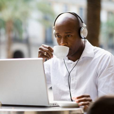man drinking coffee while enjoying benefits of flexible working