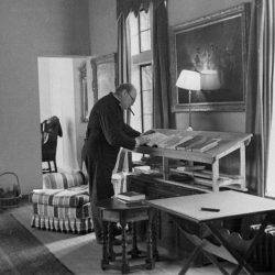 Churchill working at a standing desk