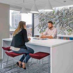 Two people in an office discuss green building design