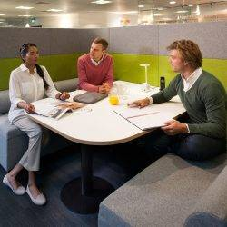 People in the sort of office design that encourages communication and better working relationships