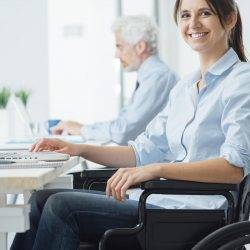 disabled people working in an office and smiling