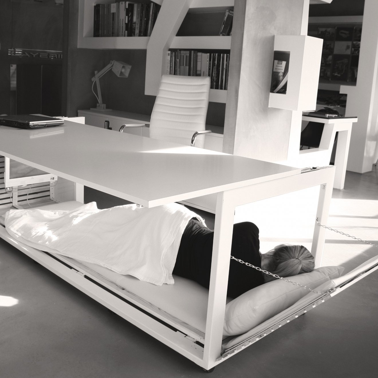 sleeping under a convertible desk