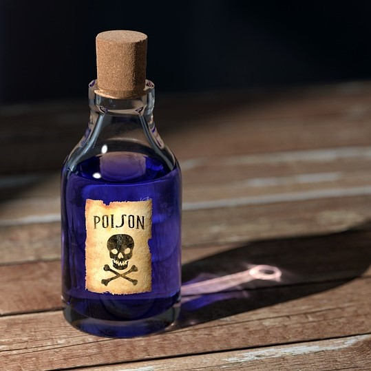 The toxic workplace illustrated by a bottle of poison