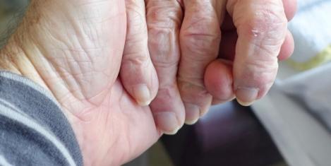 Half of 'sandwich carers' keep responsibilities hidden